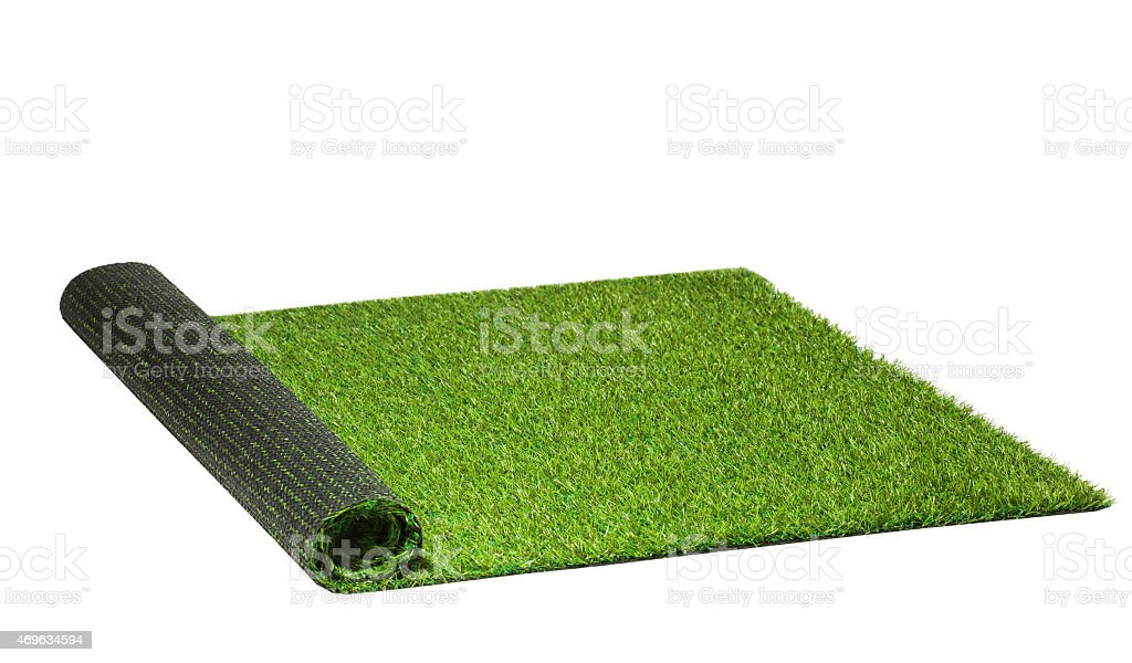 twisted artificial green grass isolated on white stock photo
