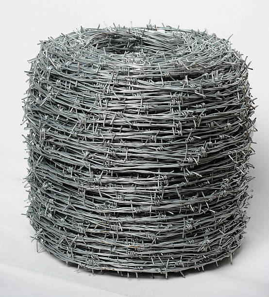 Twisted barbed wire stock photo