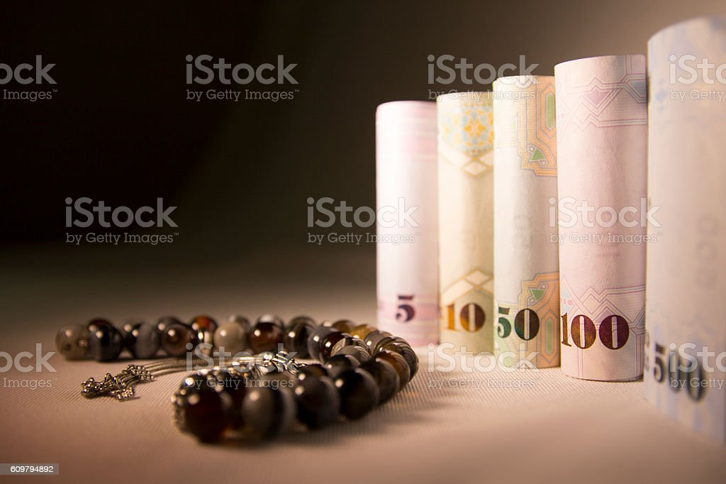 Twisted Cash money with rosary, gift for Eid stock photo