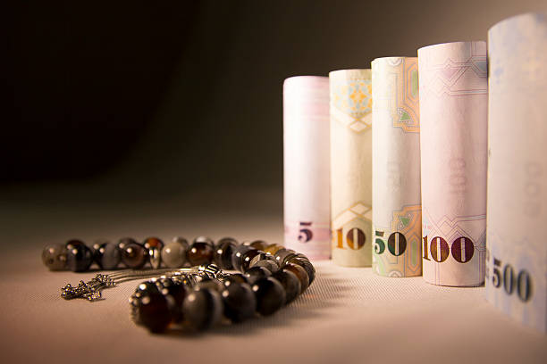 twisted cash money with rosary, gift for eid - sharia foto e immagini stock