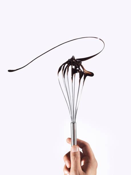 gedraaide chocolade - ballonklopper stockfoto's en -beelden
