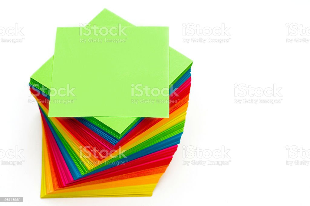 Twisted multi colored notes isolated on white royalty-free stock photo