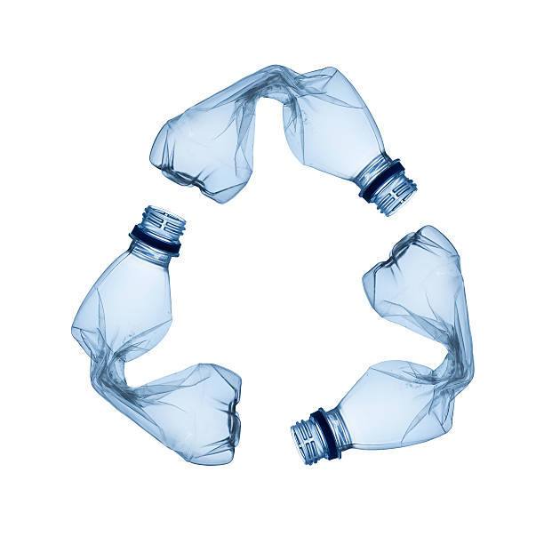 Twisted plastic bottles in the shape of the recycling symbol stock photo