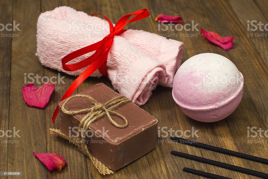 twisted towel bind red silk tape and bath bomb stock photo