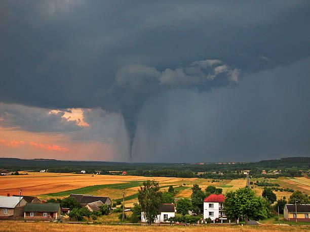 twister on countryside - tornado stockfoto's en -beelden