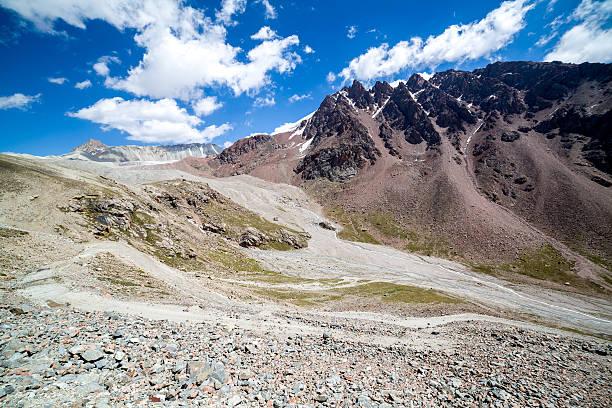 Twisting mountain road in Kirghizia stock photo