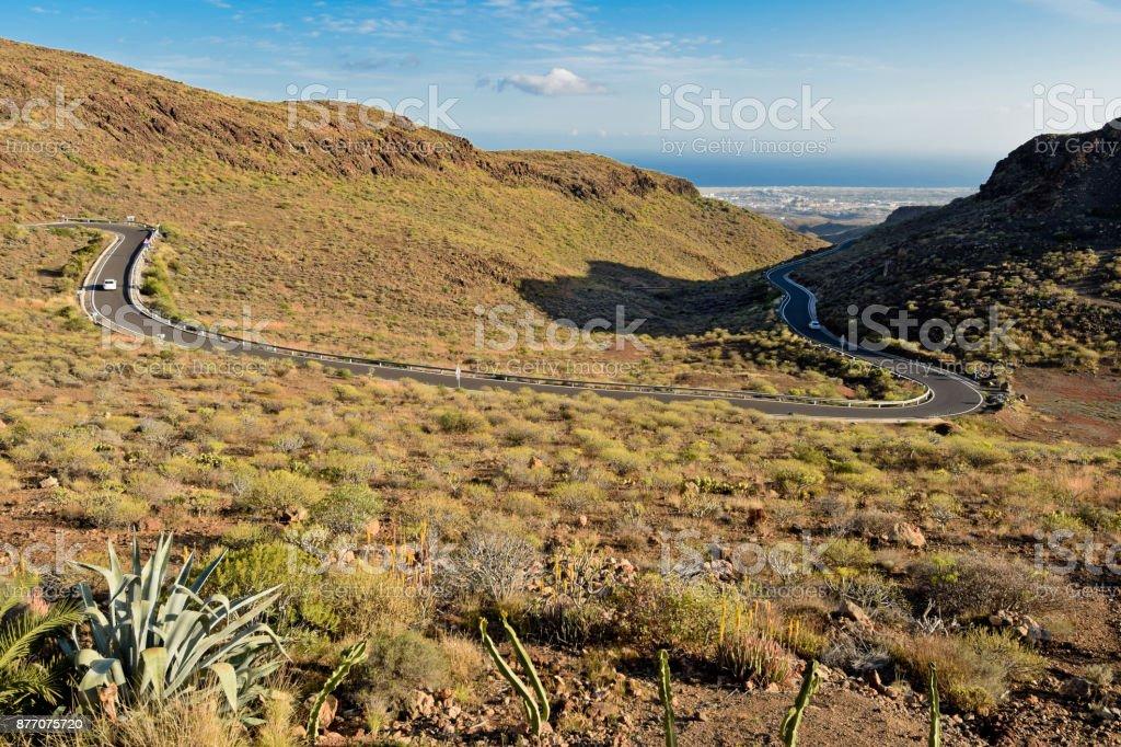 Twisty road to Maspalomas. Gran Canaria. Spain. stock photo