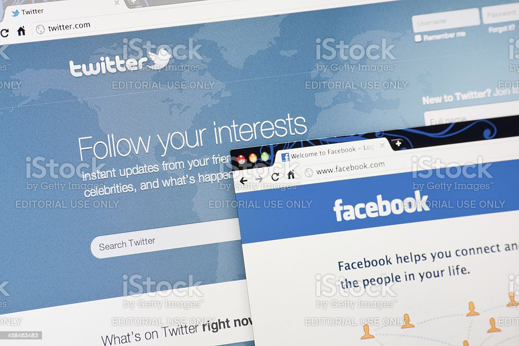 Twitter and Facebook Home Pages on Laptop Screen stock photo