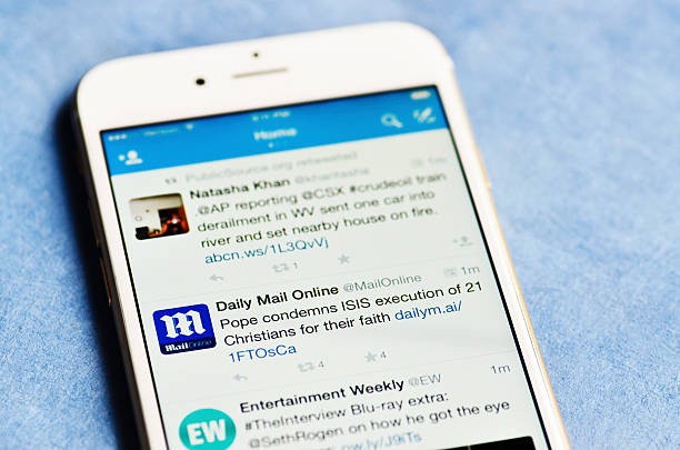Twitter Feed on iPhone 6 stock photo