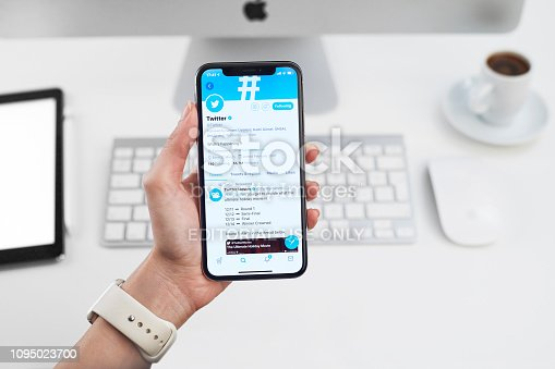 Istanbul, Turkey - December 15, 2018: Person holding a brand new Apple iPhone X with Twitter profile on the screen. Twitter is a social media online service for microblogging and networking, founded in March 21, 2006.