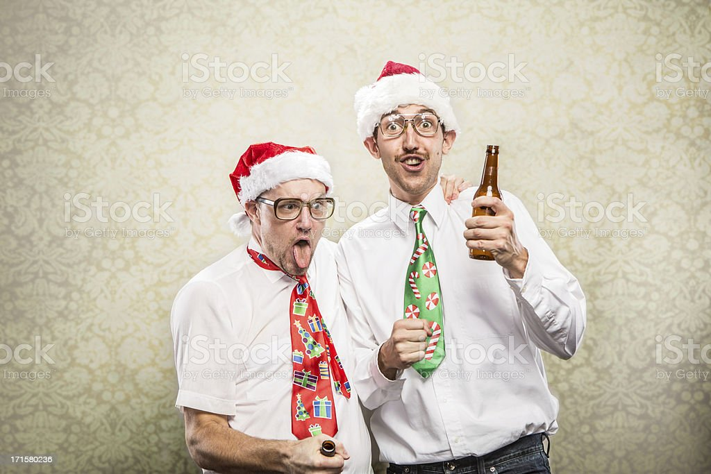 two 2 drunk goofy Christmas Tie wearing Party Nerds stock photo