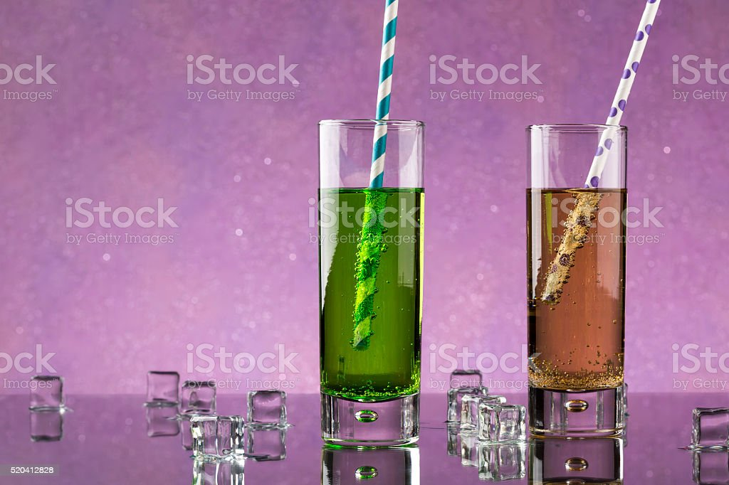 Two a collins glass from soda and colored straws. stock photo