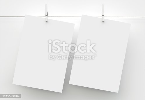 1139340462 istock photo Two A4 Paper Sheet Mockup Hanging on Rope 1222238940