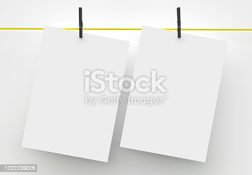 1139340462 istock photo Two A4 Paper Sheet Mockup Hanging on Rope 1222239026