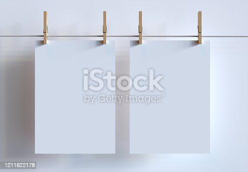 istock Two A4 Size Poster Mockup Hanging With Clothespins On Clothesline. 3d Render. 1211622178