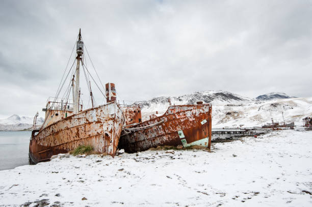 Two abandoned  whaling ships at Grytviken harbour,South Georgia stock photo