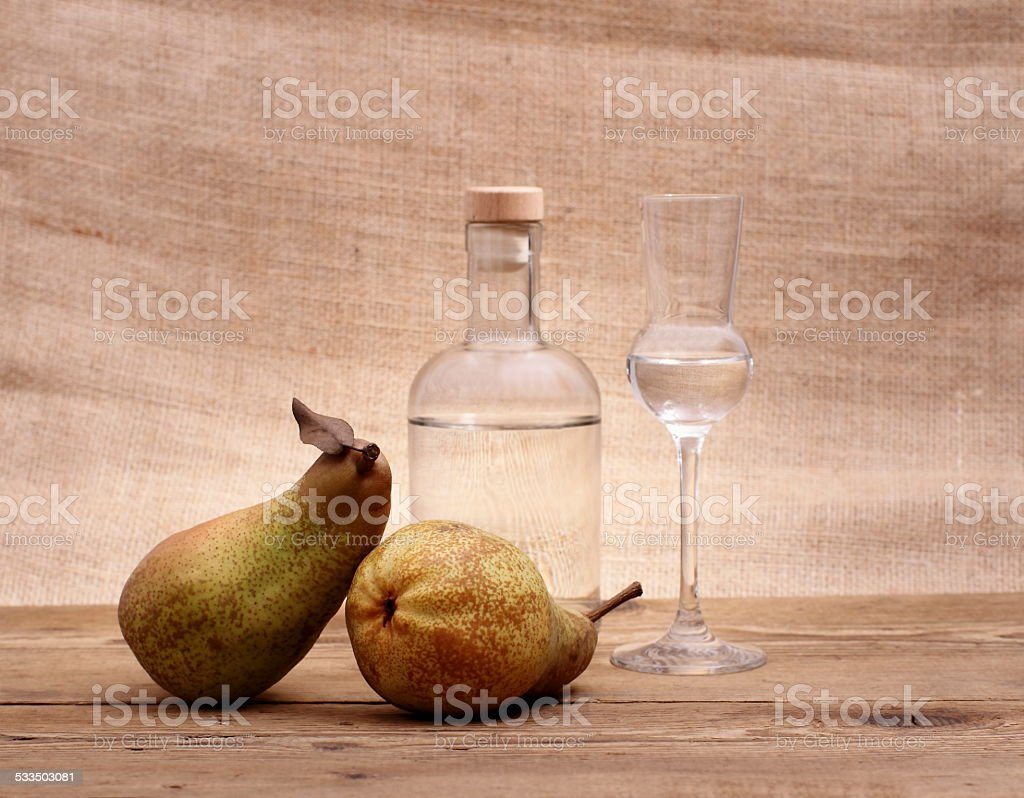 Two Abate Fetel pear with alcohol bottle and glass stock photo