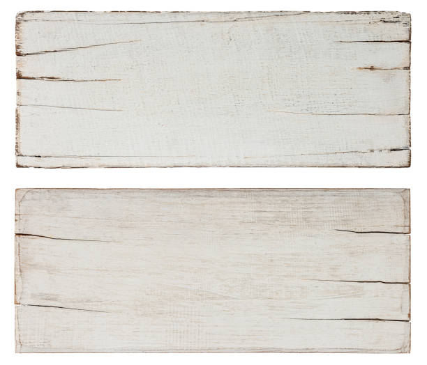 Two abstract, old, worn, weathered, cracked white wood planks along their edges, lots of texture, good copy space in the center of the planks. Isolated on white, clipping path included. stock photo