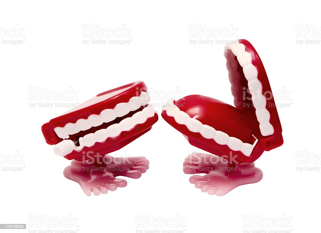 Two abstract red mouths with feet causing the other to laugh stock photo