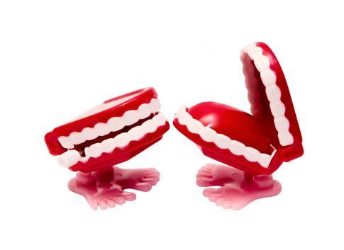 Two Abstract Red Mouths With Feet Causing The Other To Laugh Stock Photo - Download Image Now