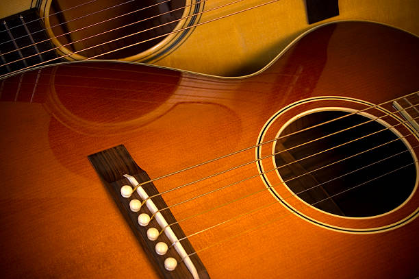 two acoustic guitars stock photo