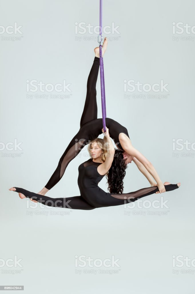 Two acrobats in a hula hoopa. stock photo
