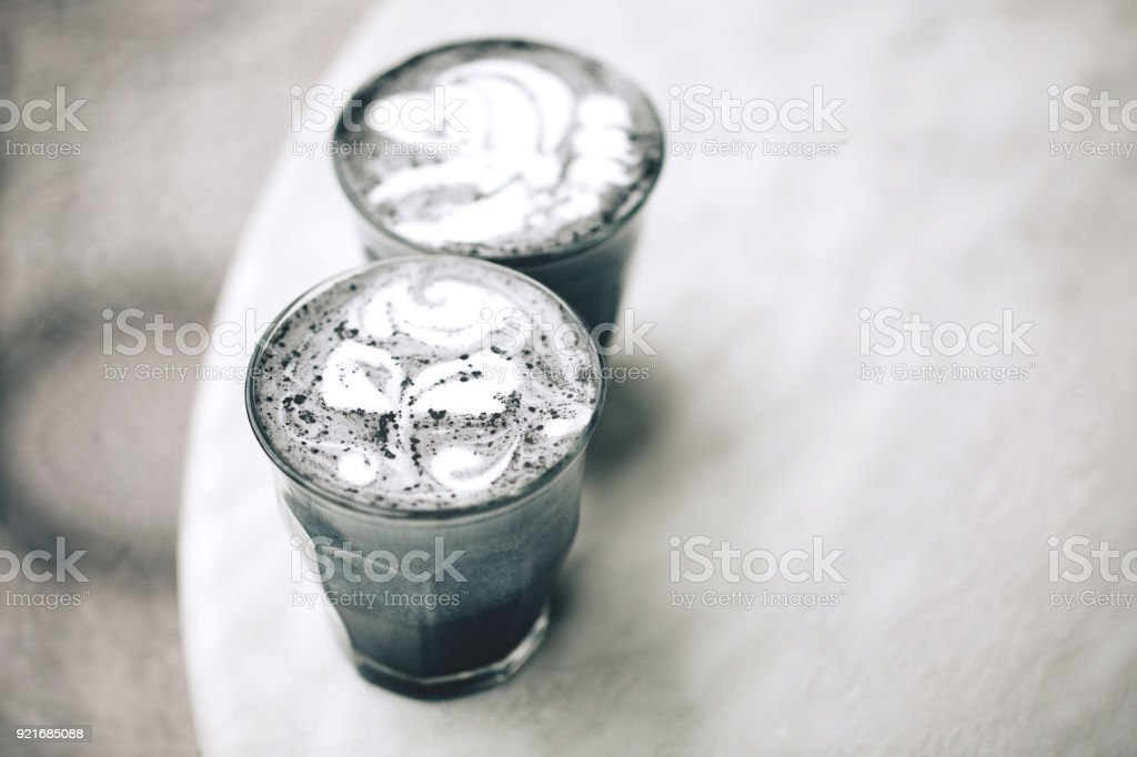 Two activated charcoal lattes stock photo