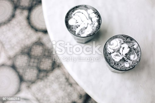istock Two activated charcoal lattes 921685214