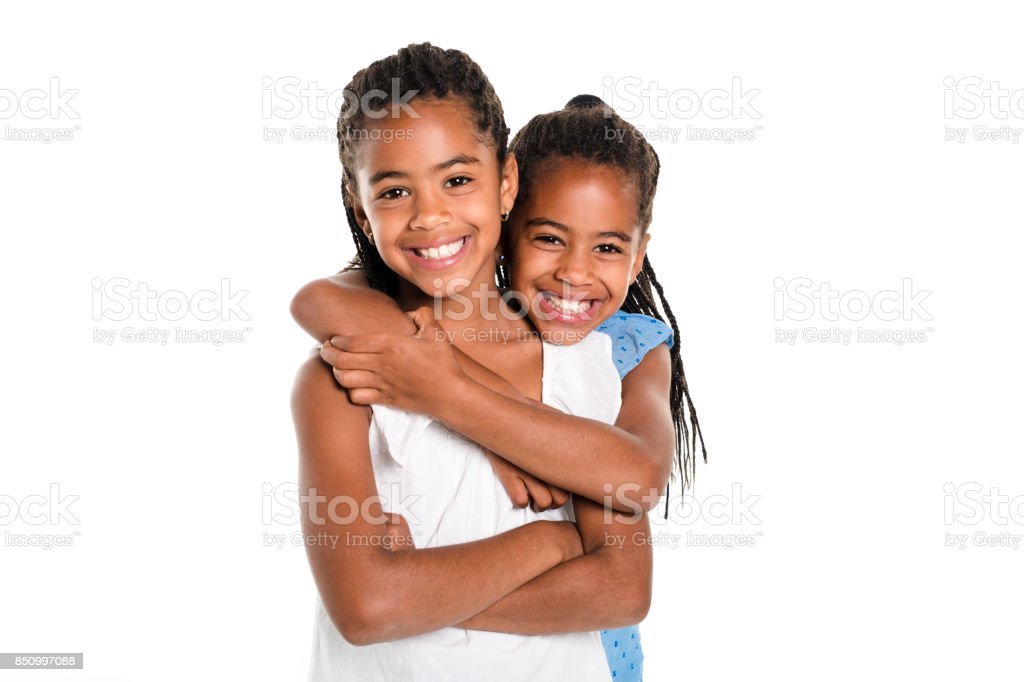Two Adorable african twin girl on studio white background stock photo