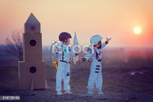 istock Two adorable children, playing in park on sunset 516728150