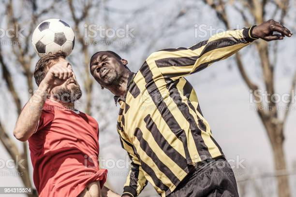 Two adult male soccer teams competing for the ball during a match picture id954315524?b=1&k=6&m=954315524&s=612x612&h=acdn5re8bngbabushiimjkaxbxni0lip1xipqlj  g8=