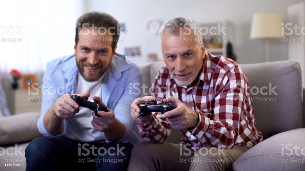 Two adult men playing video game, using joystick, leisure activity,...