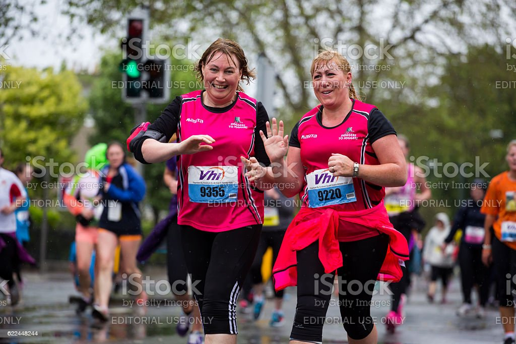 Two adults running marathon stock photo