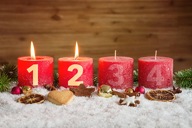 Two advent candles lit in snow – Foto