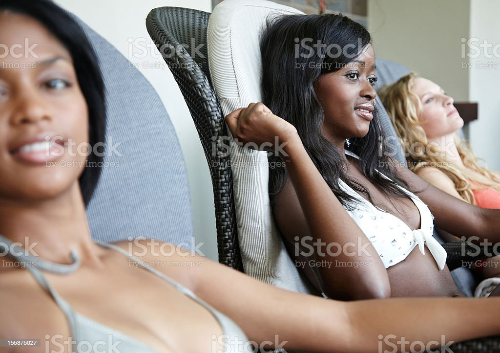 Two african beauties reclining in the spa royalty-free stock photo