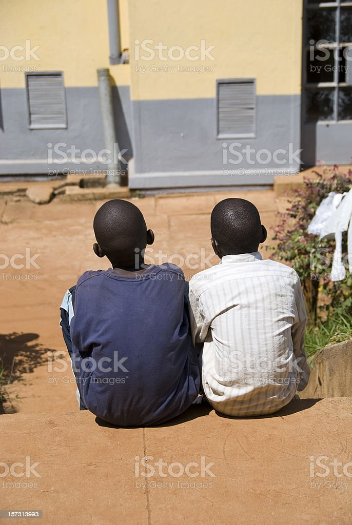 Two african boys side by side stock photo