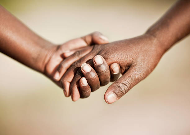 Two African Children Holding Hands stock photo