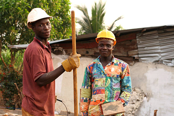 Two African men on a construction site of a house stock photo