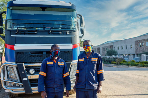 Two African trucker wearing a mask