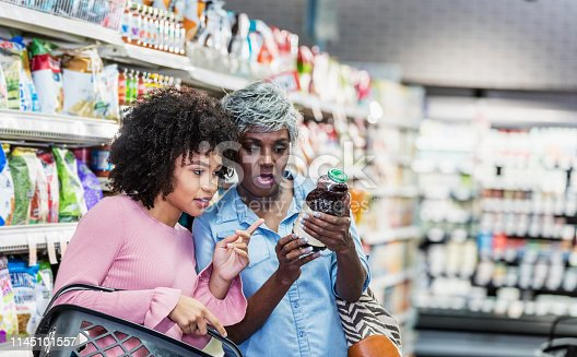 istock Two African-American women in supermarket 1145101557