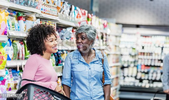 istock Two African-American women in supermarket 1171428279