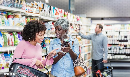istock Two African-American women in supermarket 1196818607