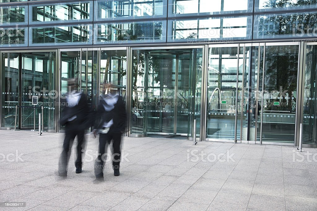 Two Afro-American Businessmen Walking in Financial District royalty-free stock photo