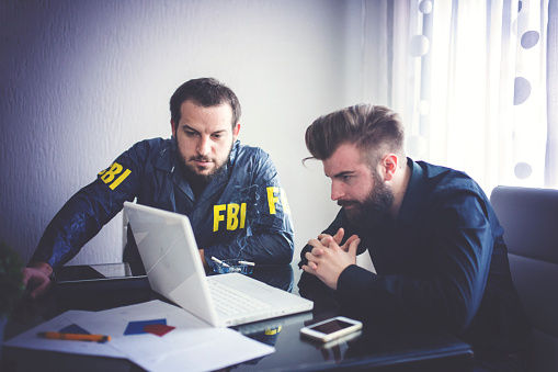 Two agents working in office