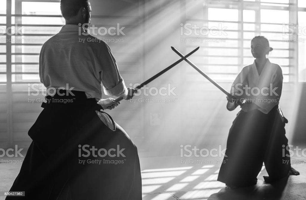 Two Aikido Fighters With Bokken Swords stock photo