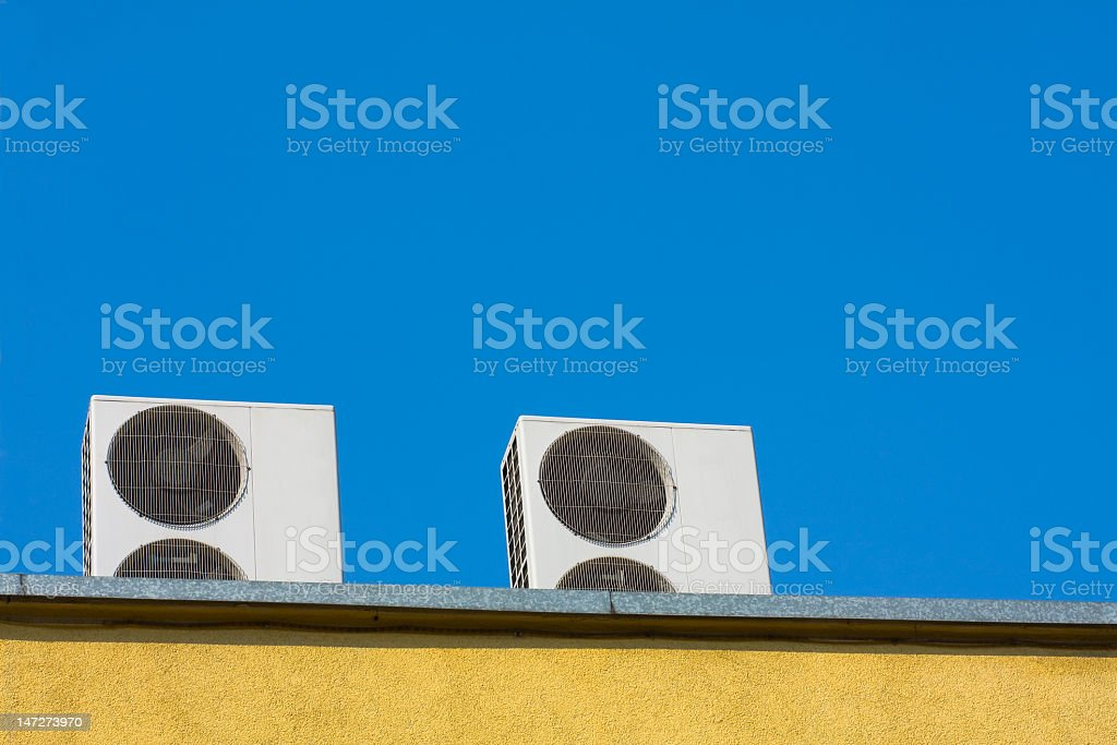 Two air conditioners units on roof stock photo