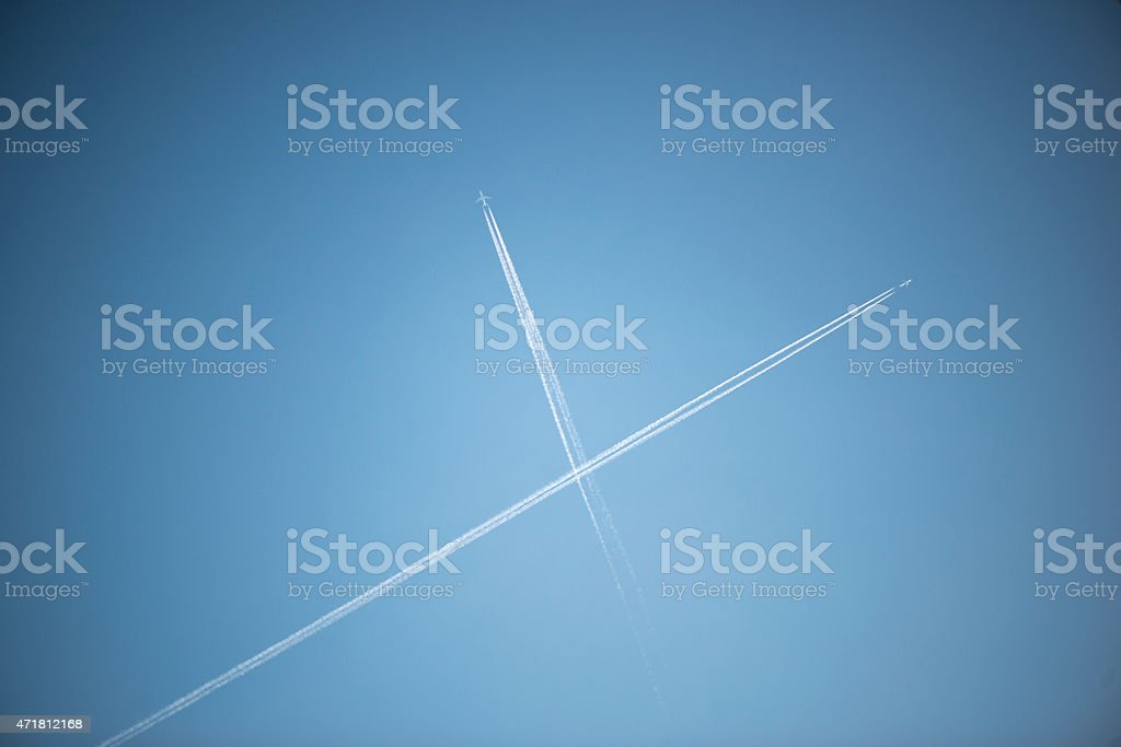 Two aircraft contrail stock photo