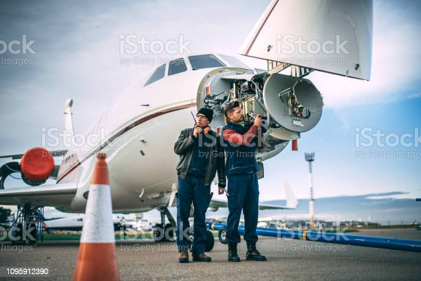 Two aircraft engineers working on a sensor array in the nose cone of picture id1095912390?b=1&k=6&m=1095912390&s=612x612&h=twydabzznncfwq0dck979b4pflzpct8ll5rjzezded8=