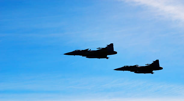 Two aircraft Jas 39 Gripen on blue sky stock photo