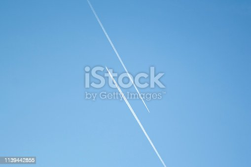 istock Two airplanes in the blue sky fly to the different ways. Creative concept of relationship. Paths diverged symbol. 1139442855